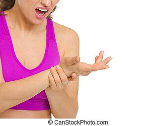 closeup kobieta, ból, nadgarstek