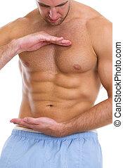 closeup, ligado, atleta masculino, mostrando, grande, músculos abdominais