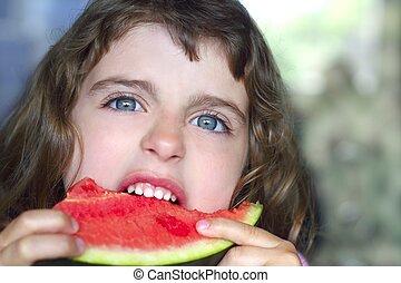 closeup little girl portrait eating watermelon slice