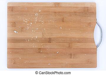 Closeup macro bread crumbs on the wooden board