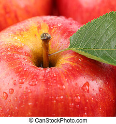 Closeup macro red apple fruit with leaf