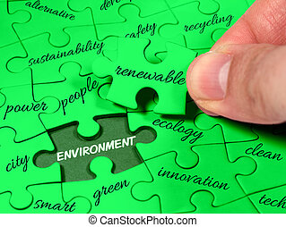 Closeup male hands holding missing jigsaw environment tag cloud green puzzle. Ecology clean energy renewable sustainability recycling concept