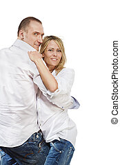 Closeup man and woman in white shirts and blue jeans look as if they dance.