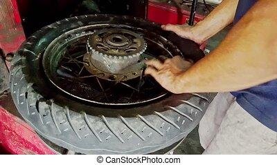 Closeup Man Binds Details to Tire Disk on Balance Machine -...