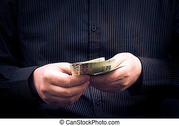 Closeup man counting money Polish