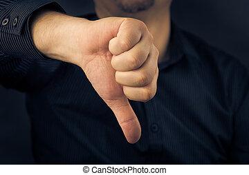 Closeup man hand showing thumbs down