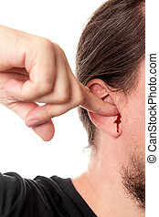 closeup man holding a finger in his ear with ear bleeding, isolated on white
