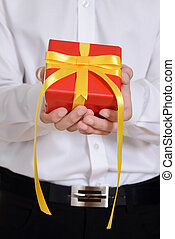 man holding red christmas present