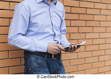 Closeup man with digital tablet in hands.