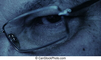 Closeup Man's Eye In Glasses Works On computer cinematic...