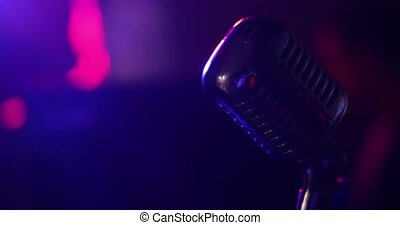Closeup microphone on stage against auditorium background on...