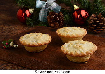 closeup mincemeat pies with christmas ornaments