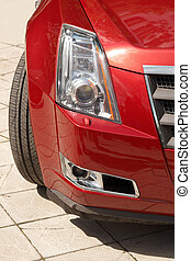 Closeup modern car headlight and fog lamp. Vertical image