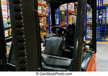 Closeup modern electric forklift truck.