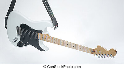 closeup .modern electric guitar on a white background.