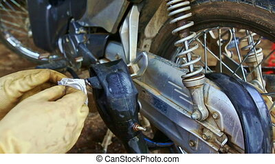 Closeup Motorcycle Rear Wheel and Brakes in Repair-shop -...