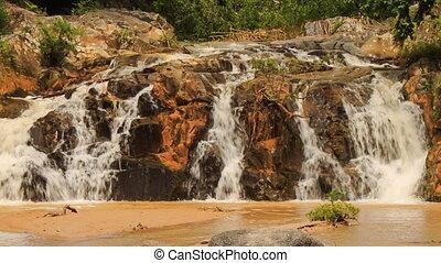 closeup mountain streams falling among stones in park