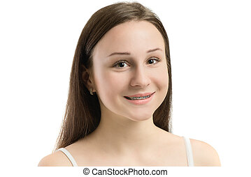 Closeup multicolored Braces on Teeth. Beautiful Female Smile portrait with Self-ligating Braces. Orthodontic Treatment.