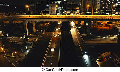 Closeup night traffic highway: cars drive aerial. Urban transport ride at road. Philippine cityscape