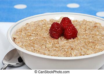 closeup oatmeal with raspberries