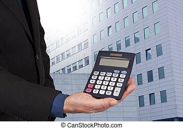 closeup, od, przedimek określony przed rzeczownikami, kalkulator, w, ręka, pojęcie, od, finanse, i, ekonomika