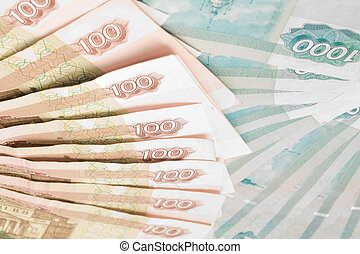 Closeup of 100 and 1000 roubles banknotes