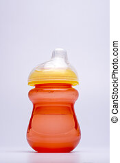 closeup of a baby feeding bottle in isolated white background