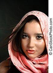 Closeup of a beautiful girl in scarf