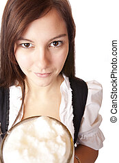 Closeup of a Beautiful woman holding Oktoberfest beer stein