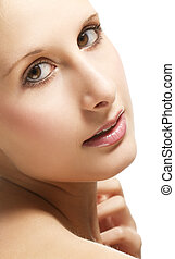 closeup of a beautiful woman looking over her shoulder on white background