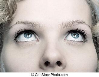 closeup of a beautiful woman looking up