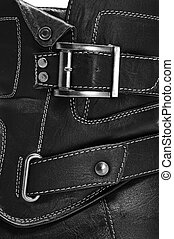boot - closeup of a black leather boot with straps