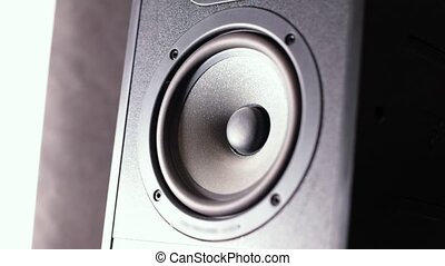 Closeup of a black vibrating working subwoofer. Slow motion