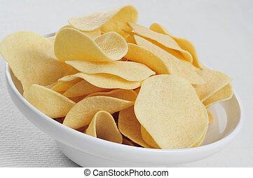 low fat potato chips - closeup of a bowl with low fat potato...