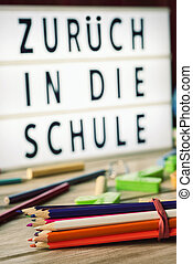 zuruck in die schule, back to school in german - closeup of...