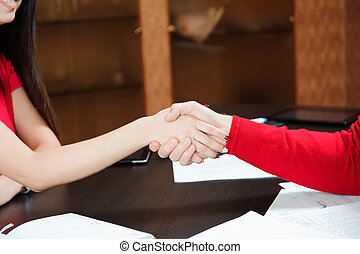 Closeup of a business handshake Business coach holding training for staff