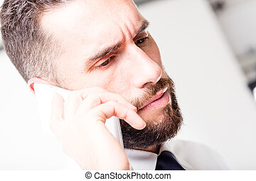 closeup of a business man speaking on the phone