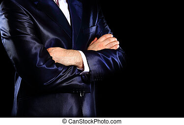Closeup of a business man's hands folded