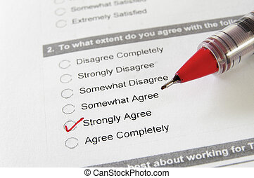 closeup of a business survey, with Strongly Agree checked