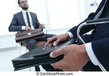 Closeup Of A Businessman Holding Briefcase