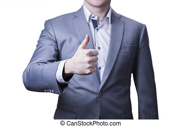 Closeup of a businessman in grey suit giving the thumbs up.