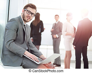 closeup of a businessman with a stylish laptop on the knees on t