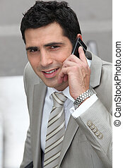 Closeup of a businessman with cellphone