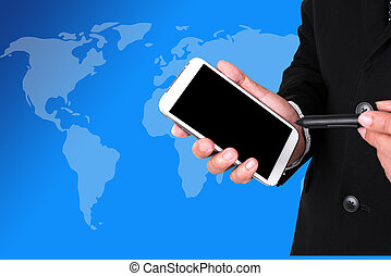 Closeup of a businessman's hands with a pocket pc, world map...