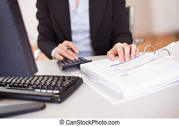 Closeup of a businesswoman doing finances