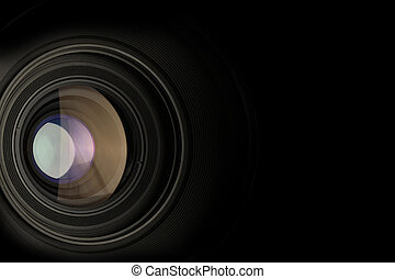 closeup of a camera lens on black background