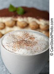 closeup of a cappuccino with tiramisu