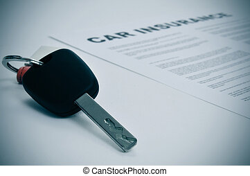 car insurance - closeup of a car key and a car insurance...