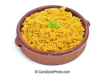 closeup of a casserole whit spiced couscous on a white background