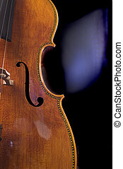 Closeup of a cello - closeup of the scroll work on a...